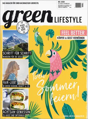 Titelbild der Ausgabe 03/2021 mit gelben Hintergrund und bunte, Vogel