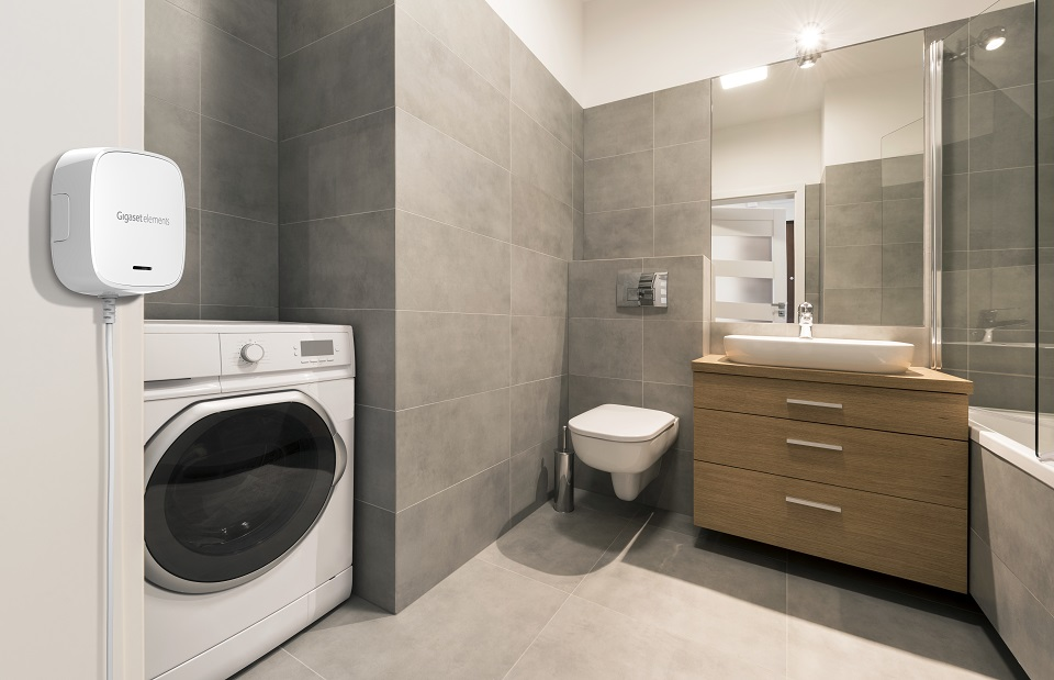 Modern bathroom with tiles on the floor in stylish apartment